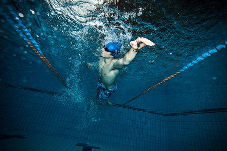Swimmer at the swimming pool.