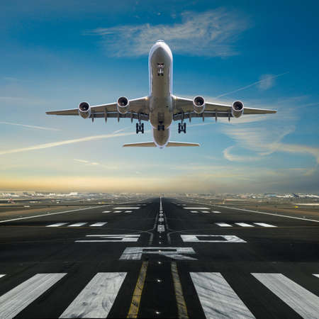 Airplane taking off from the airport runway Foto de archivo