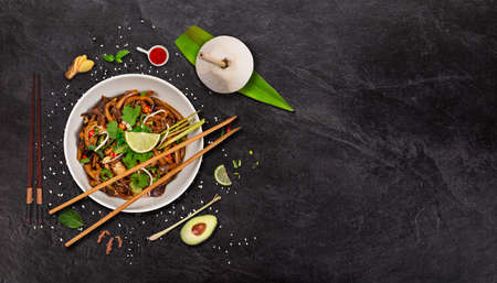 Udon noodles asian food background on rustic stone table. Zdjęcie Seryjne