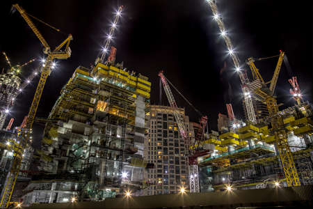 Building at construction process during night.