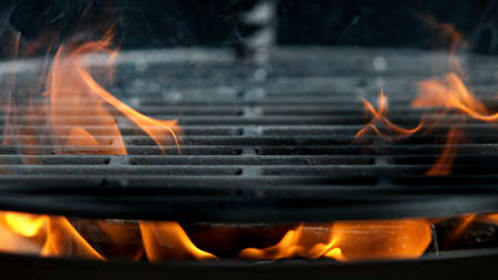 Empty flaming charcoal grill, ready for product placement.