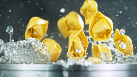Throwing pasta into boiled water