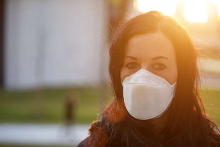 Woman in city with a face mask against infection Stok Fotoğraf