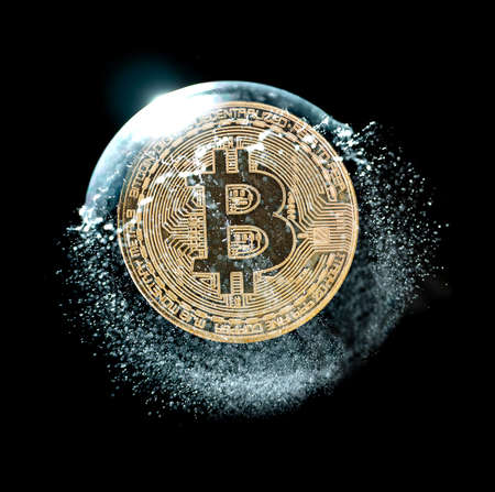 Bitcoin coin in a soap bubble. Concept of instability of the crypto currency