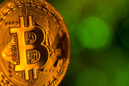 Bitcoin gold coin with defocused abstract background. Stok Fotoğraf