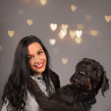 Happy brunette girl with her dog.