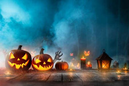 Halloween pumpkins on dark spooky forest. Stok Fotoğraf