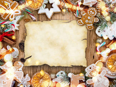 Christmas decoration with blank paper on wooden background