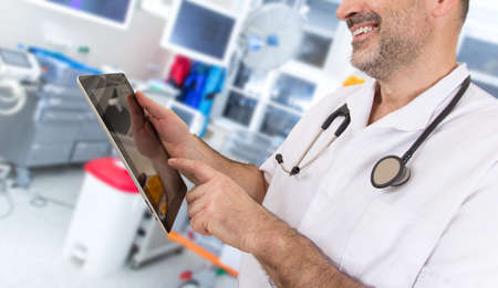 Doctor with stethoscope and tablet in a hospital