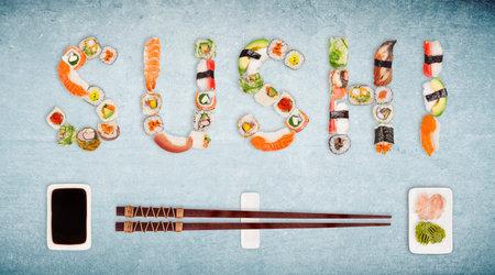 Traditional japanese sushi pieces making inscription. Foto de archivo
