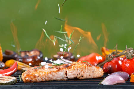 Assorted delicious grilled fish meat with vegetables.