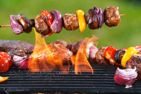 Delicious skewer falling down on a barbecue grill