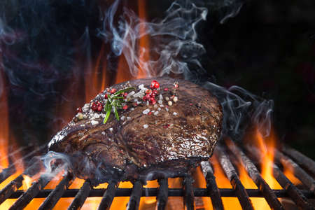 Delicious grilled beef steak on a barbecue grill