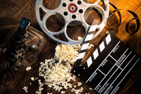 Cinema concept of vintage film reels, clapperboard and other tools