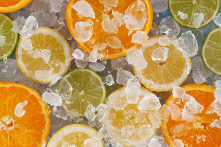 Sliced citrus fruits with crushed ice.