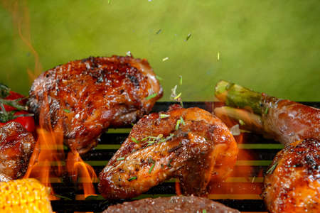 Delicious grilled chicken legs on a barbecue grill