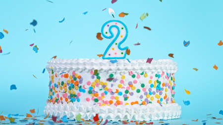 Colorful tasty birthday cake with candles shaped like the number 2.