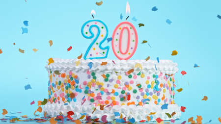 Colorful tasty birthday cake with candles shaped like the number 20. Standard-Bild