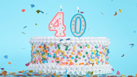 Colorful tasty birthday cake with candles shaped like the number 40. Standard-Bild