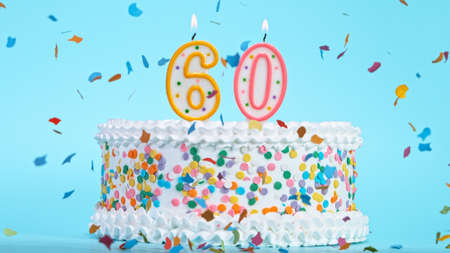 Colorful tasty birthday cake with candles shaped like the number 60. Standard-Bild