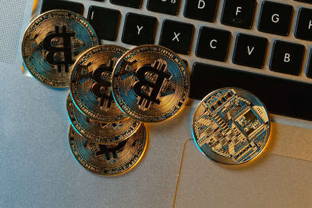 Groups of bitcoin is place on the keyboard of the laptop. Online payment technology