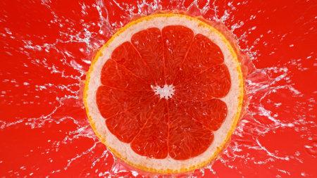 Fresh grapefruit slice falling into splashing water splashing