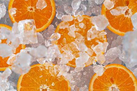 Sliced fresh oranges with crushed ice.
