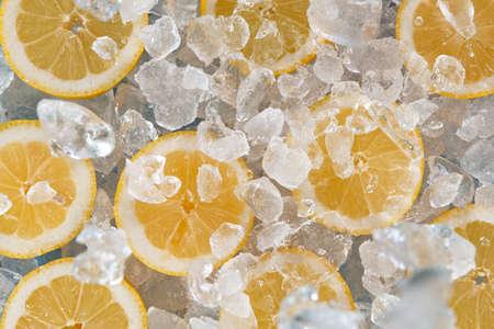 Sliced fresh lemons with crushed ice.