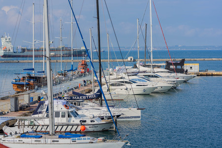 Odessa Commercial Sea Port and Marine Station.Sea entrance to the port, yachts, cargo ships and lighthouse Stock Photo