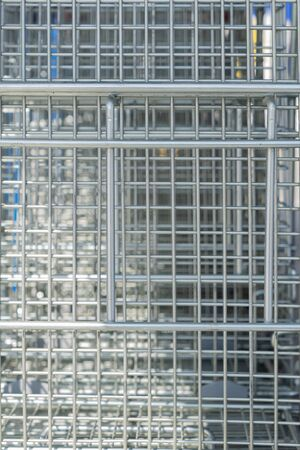 Creative background of metal mesh. Natural structure of stainless steel