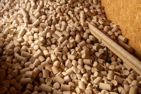 Pellets from pressed sawdust, solid fuel, non-waste technology. Handicraft production. Saving natural resources Archivio Fotografico - 131188214