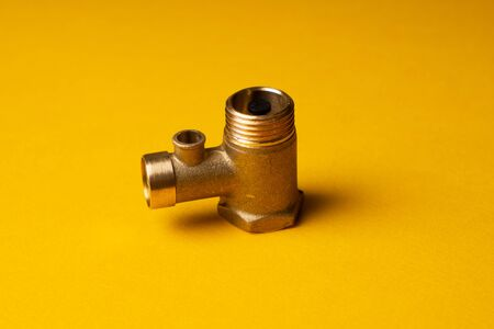 Bronze Check Valve. Non-return valve for water in the electric water heater system. On a yellow background Imagens