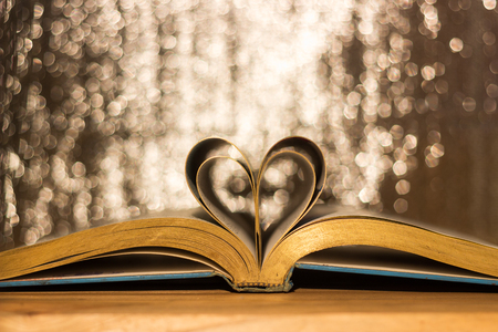 Book of love Heart shaped at the book with a blurry background. Stock Photo