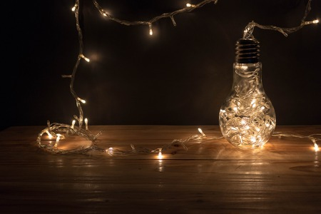 wood table with background garland lights from led