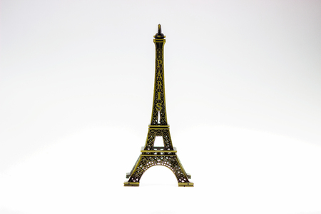 Eiffel Tower steel model placed on a white isolated background.