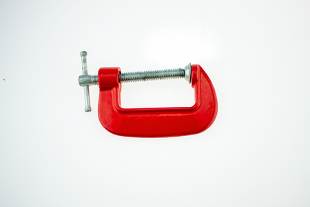 C-clamp steel for DIY or for construction purposes. Used to compress the object to fix the problem, making the workpiece stagnant during the workpiece is placed on a white background isolate.