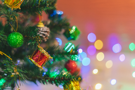 Fir tree are designed and decorated with balls and colorful gift boxes for Christmas celebrations, each of which is a happy day of winter. The background has a bokeh after blurry. Reklamní fotografie