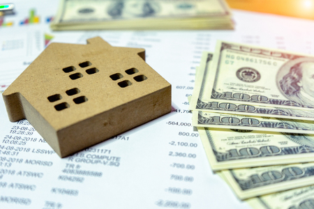 Planning to loan to buy land and build a house with the bank is part of the financial investment business for the future success of people using salary to pay interest on dollar currency.Money concept 写真素材