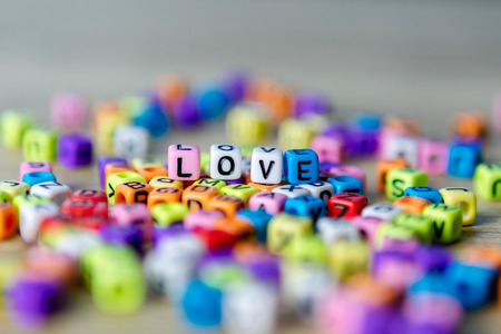 Beautiful beads colorful placed on the table as Love 写真素材