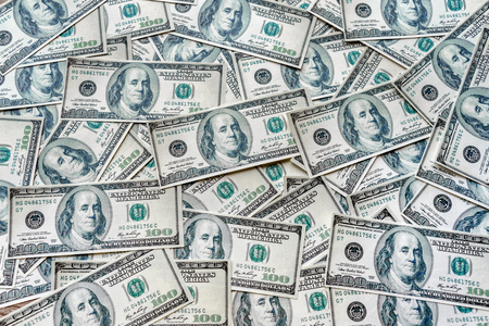 The top view concepts of the dollar banknotes currency in the United States of America shows the success of investing in the financial business in the global economy and may include liabilities.