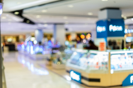 Blurred  inside interior shopping mall modern have colorful bokeh for background images.