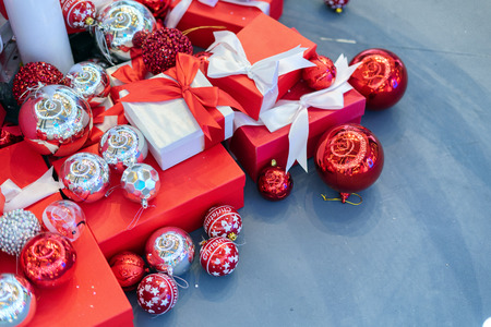 Top view on the red gift box is placed on the floor for the new year event. And Christmas or Valentine