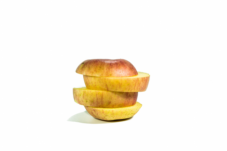 Sliced apples, stacked isolated on a white background