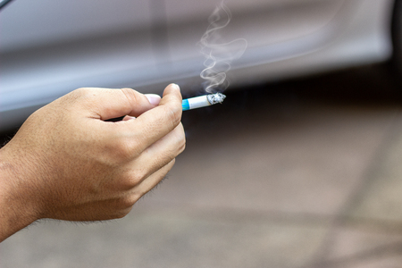 The concept of smoking cessation with male hands is carrying smoke cigarettes drugs, which are harmful to people around and dangerous to their own health, which causes lung cancer.