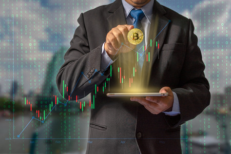 Transactions on the Internet by trading through bitcoin currency blockchain technology through financial data through secure wallet makes it important for future global economic system investments. 写真素材