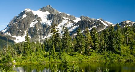 A view of Mount Shuksan from Highwood Lake in the Heather Meadows region.