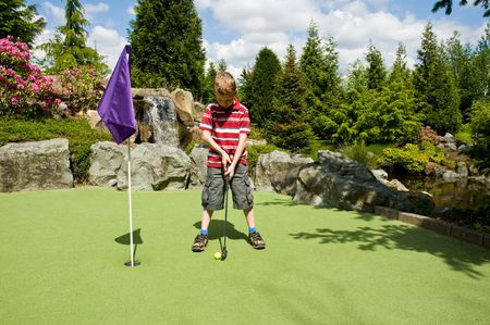 putt: A relaxing day playing putt-putt golf as a child. Stock Photo