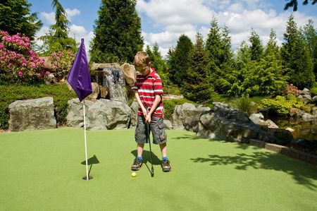 A relaxing day playing putt-putt golf as a child. Фото со стока