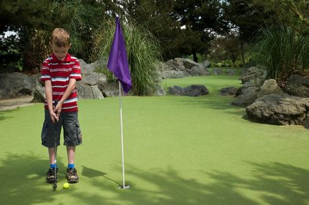 A relaxing day playing putt-putt golf as a child. Stock Photo