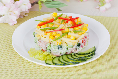 heathy diet: spring salad with corn, cucumber and sweet pepper